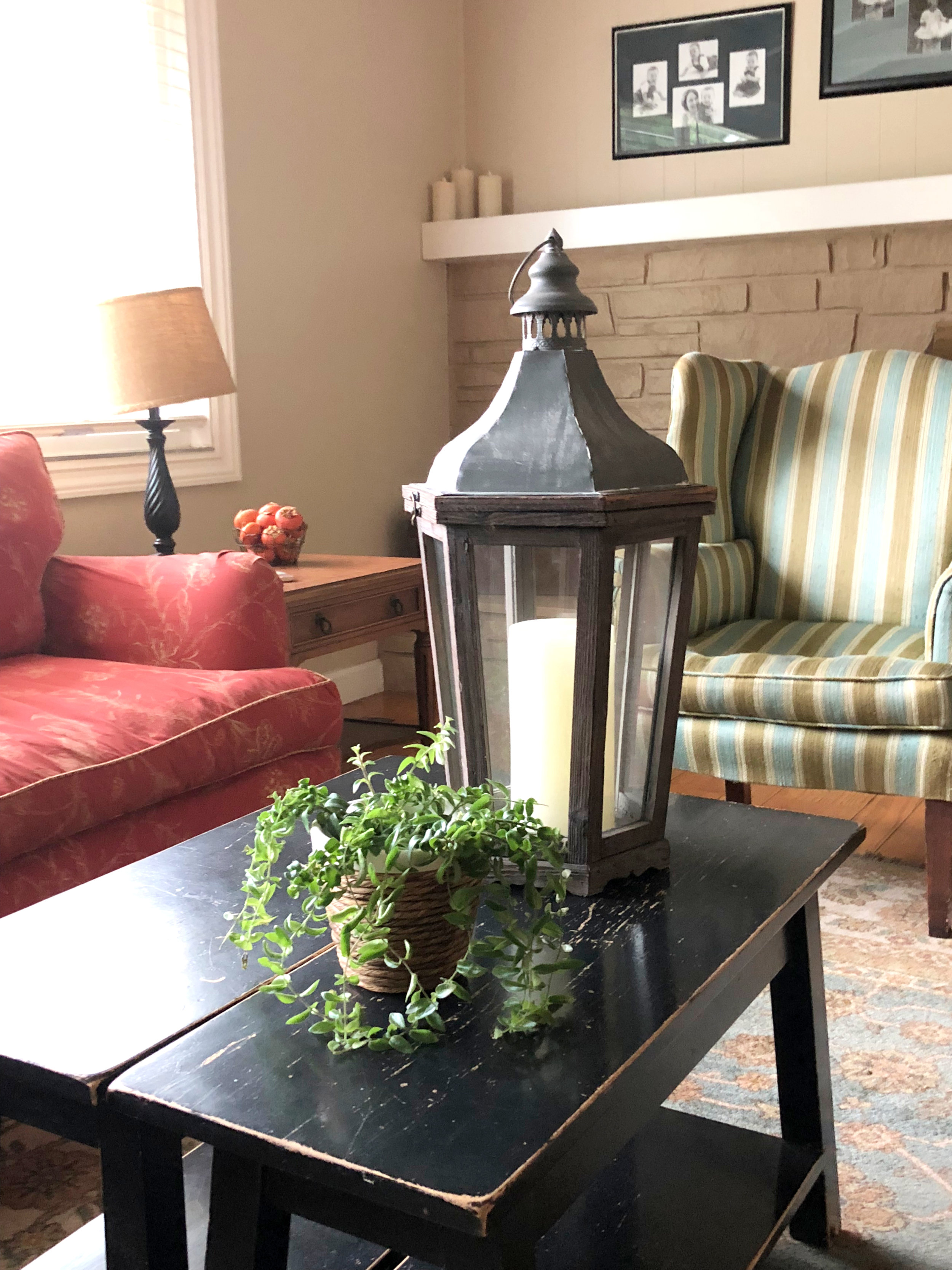 In this case, perhaps the metal and wood of the lantern will set the tone and other items will follow the theme of metal and wood…