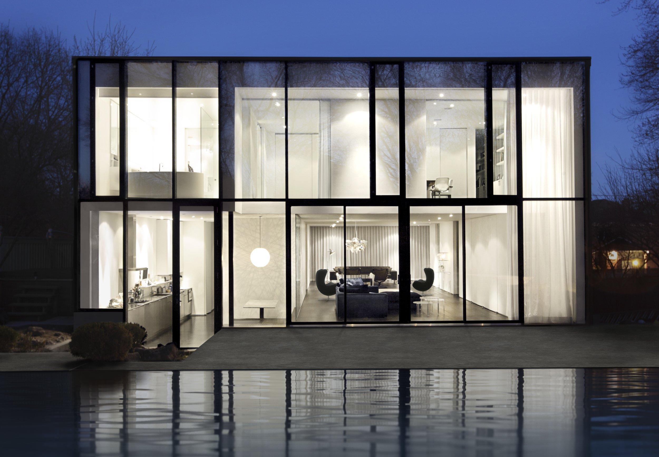House 60 - back wall two storey window wall pool backyard elevat