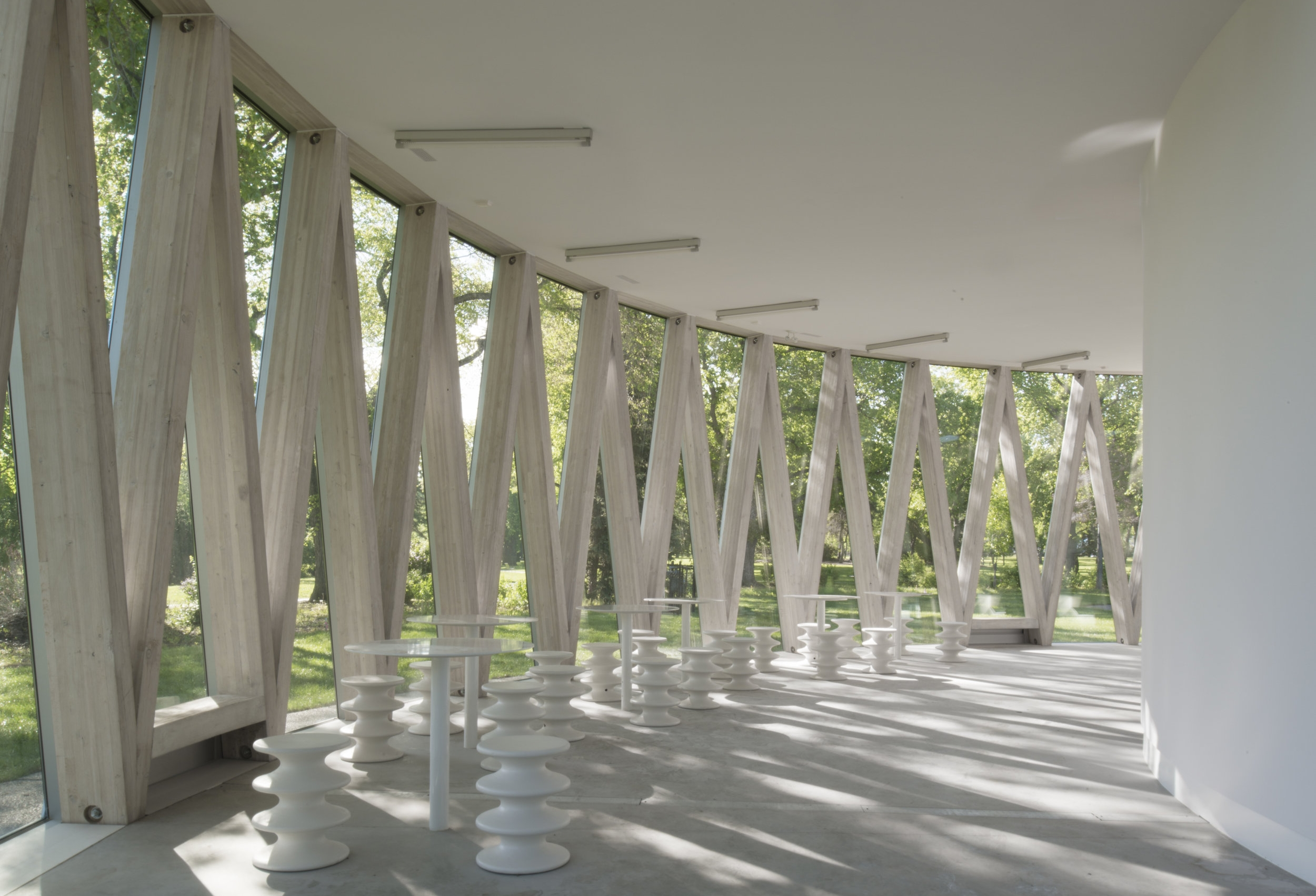 Borden Park Pavilion - interior wood and glass structure and fur
