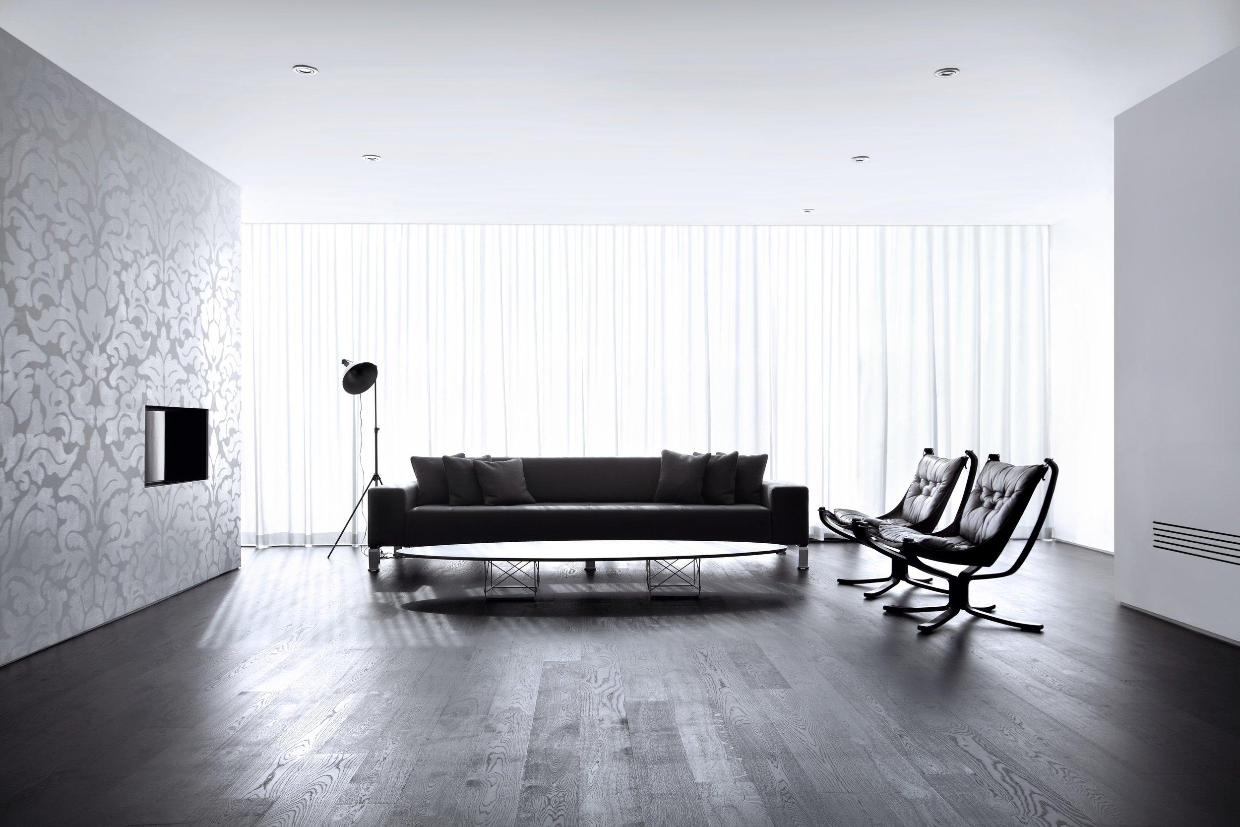 House 60 - living room patterned wall black floor