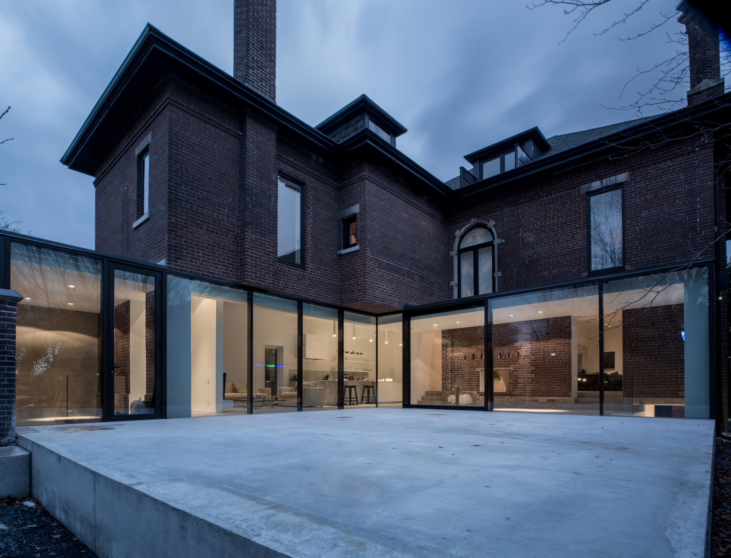 Copy of Street House - exterior glass wall dusk