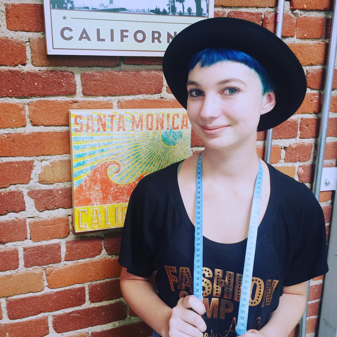 Chloe Taylor  - Team Fashion Camp Alumni  Chloe is an aspiring fashion designer. She will be attending Otis College of Art and Design in the Fall with a merit scholarship in artistic and academic abilities. Chloe is currently working at a hosiery company as a sock design intern as well as experienced in creating portfolios. She attended Team Fashion Camp for three years, then joined the staff for a fourth. Her goals include a BFA in fashion design along with eventually having her own label. She has wanted to be in fashion her entire life and is very excited to be entering that world.