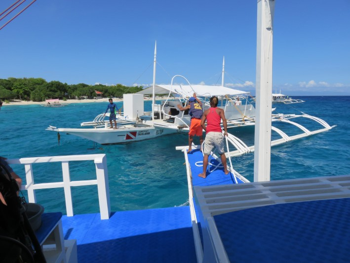 Our dive boat rafting up to another off Balikasad Is