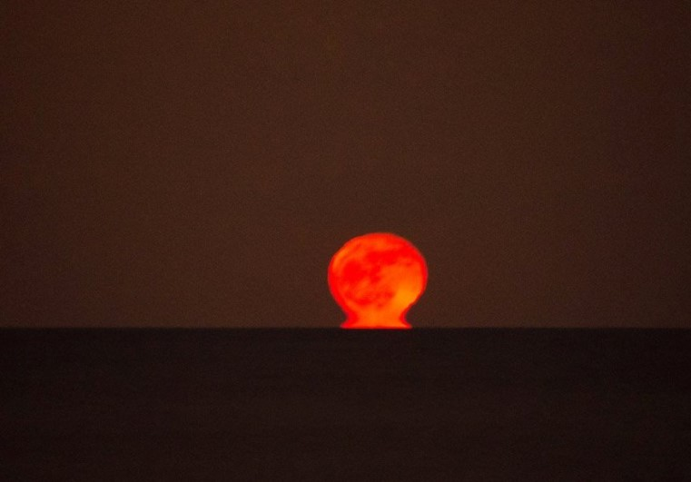 Like a big red ball of fire, amazing sight over the water