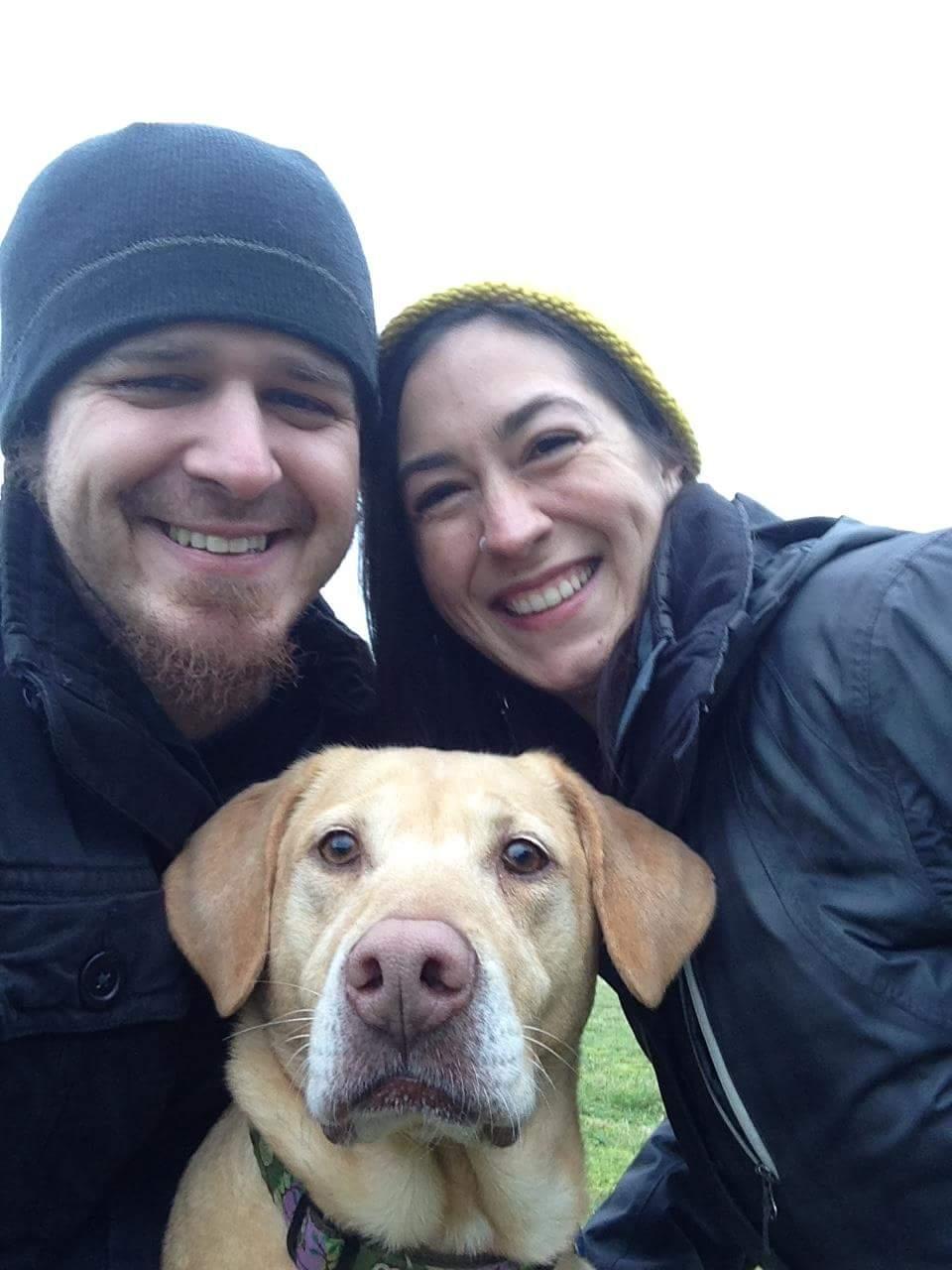 Krisha, with her husband, Greg, and their dog, Roxie