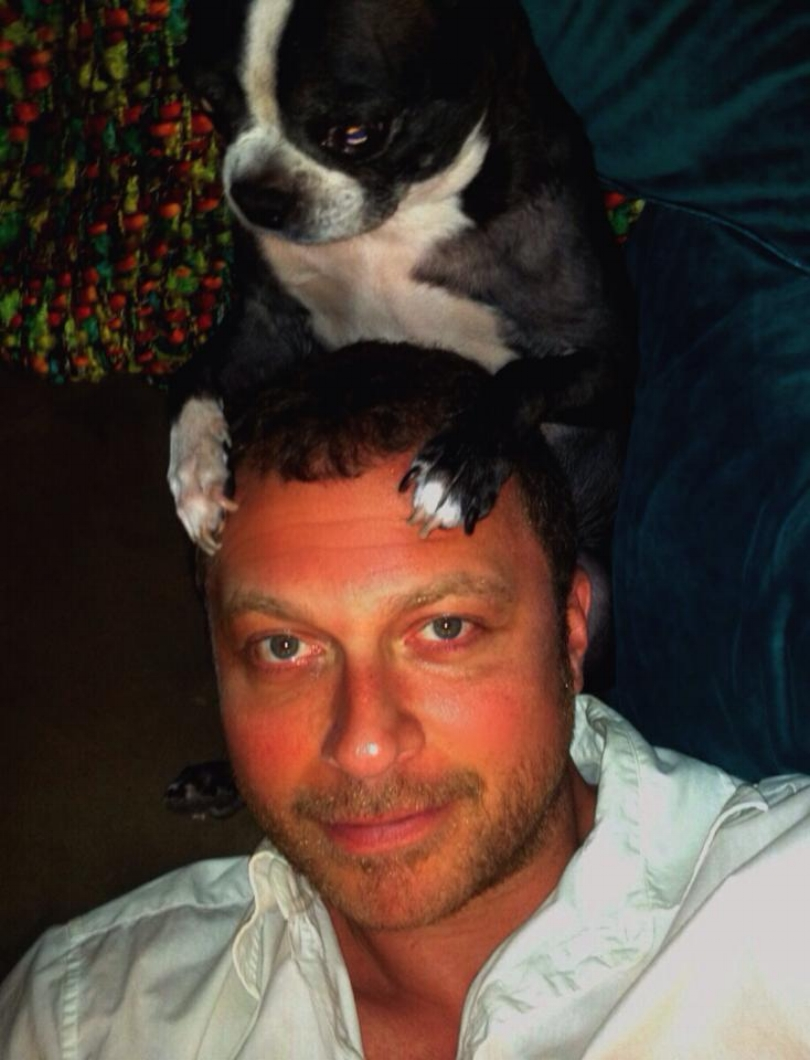 Always to the rescue, my fiancee's Boston Terrier, Rudie, is trying to ease the mild sunburn with a head massage. Thanks, Rudes.