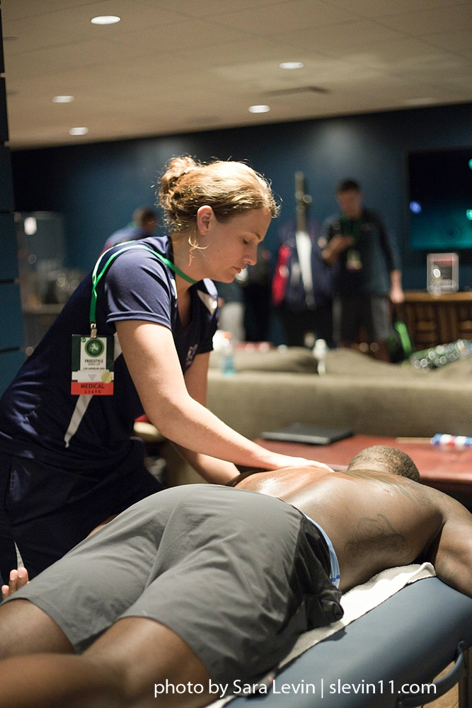 Quick recovery massage between matches at a World Wrestling event.