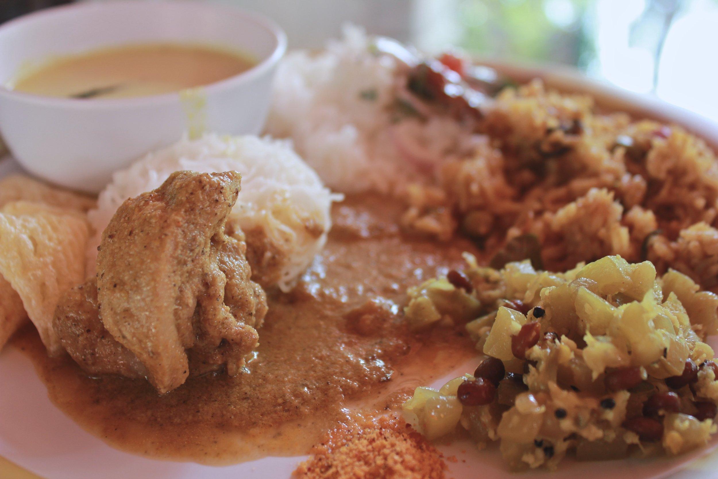 Chicken kuzhamba, poriyal, mor kuzhamba, idiyappam, biryani and raita for lunch - Karnataka food - Kannadiga food