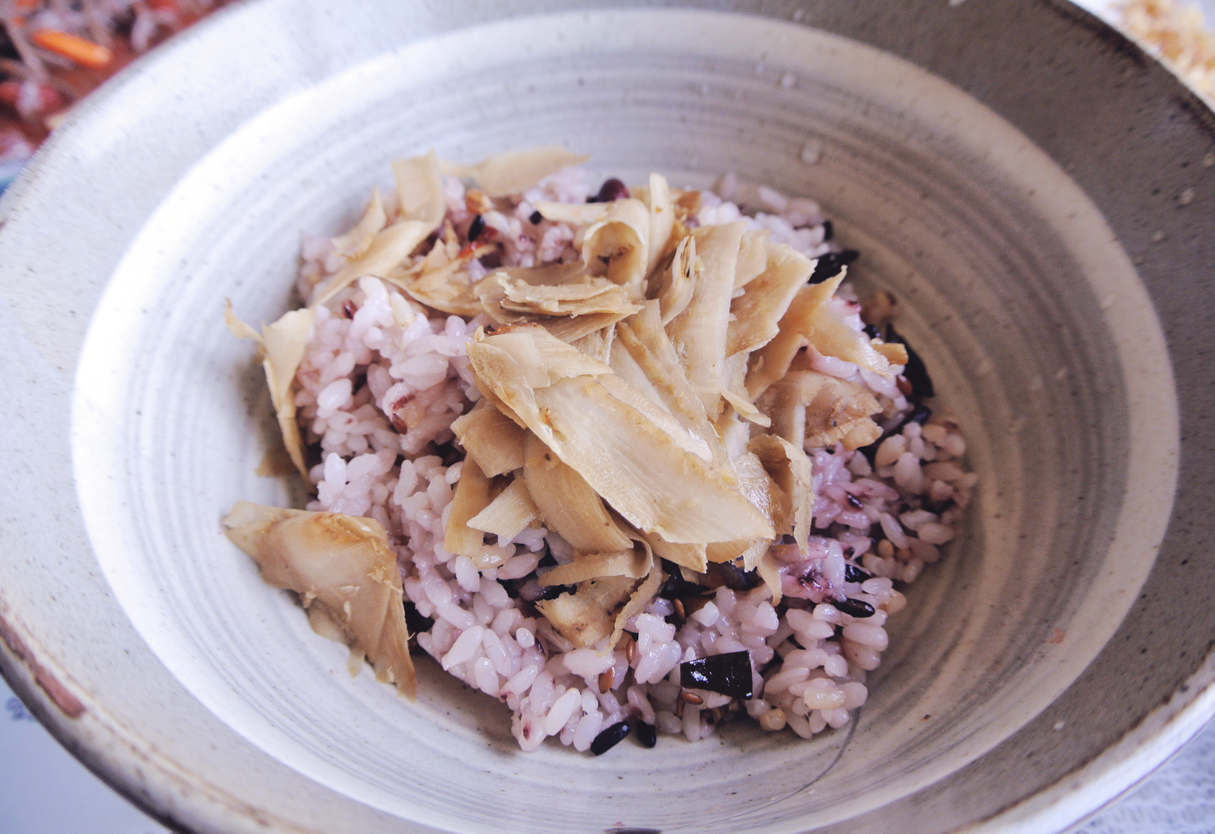 Ueongteopbap - Burdock root mixed rice at the Jayeoneuro restaurant on Jeju Island.