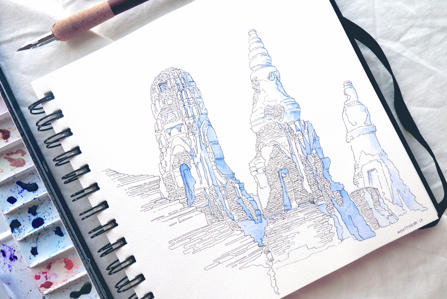 Temple Blues - The melancholic atmosphere of the Ayutthaya temple city ruins inspired this sketch. I painted and drew my impressions and memories from a trip to Thailand to have a creative, artsy diary for the future. I really like how the simple watercolor shading turned out for this line drawing of ruins.