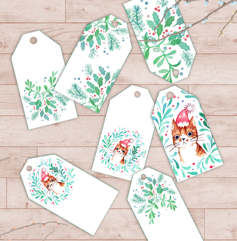My printable Christmas gift tags with watercolor cat and mistletoe wreath illustrations. These are perfect for decorating cute gifts for cat lovers or artists. Each of the individual tags has a unique design, and you can print the tags again and again on paper of your choice.