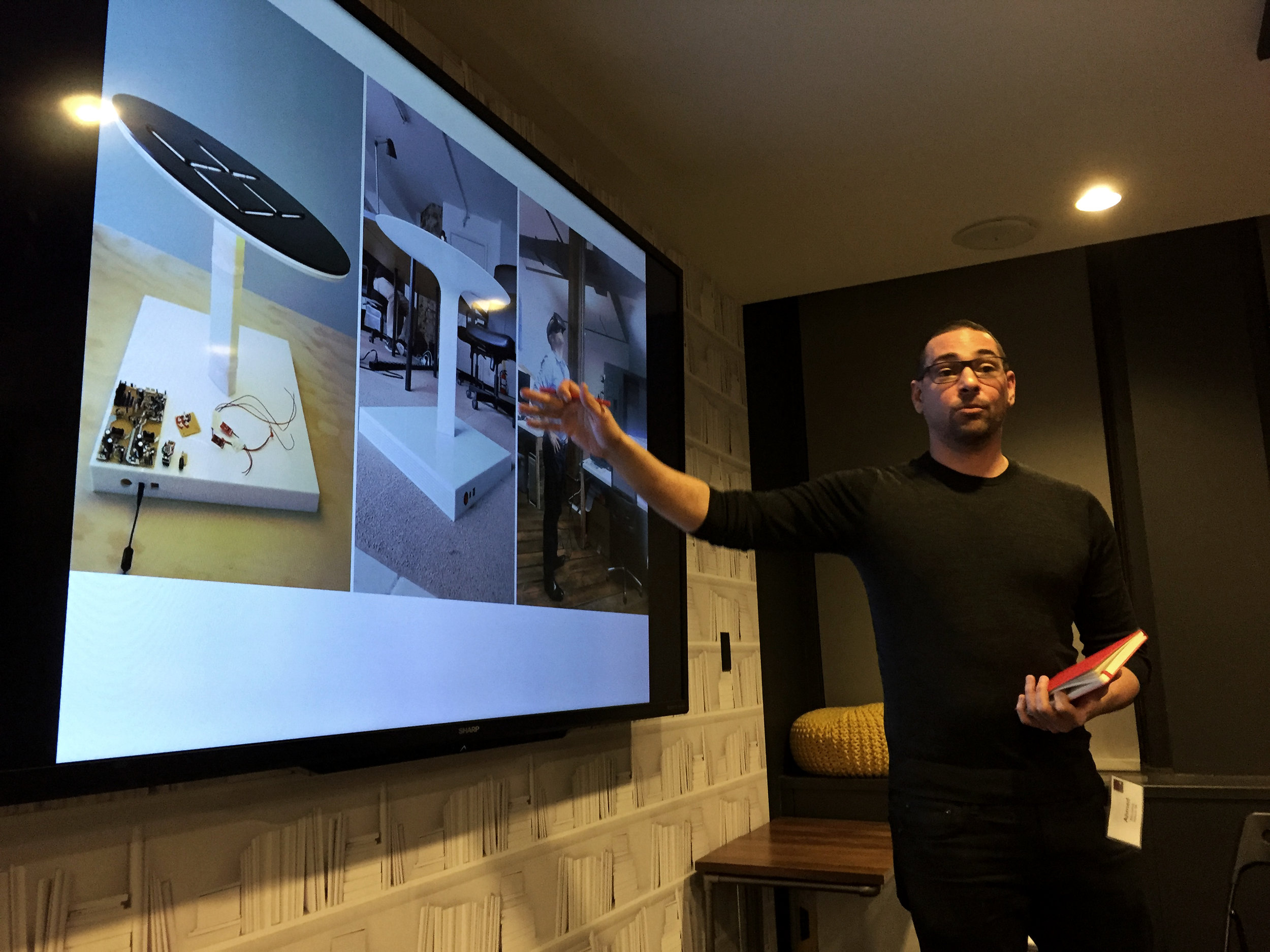 Ahmed Elhusseiny MArch '06 presenting his personal design work.