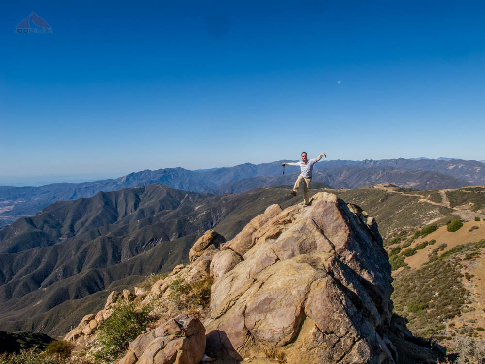 Craig, doing The Crane on top of Chief Peak