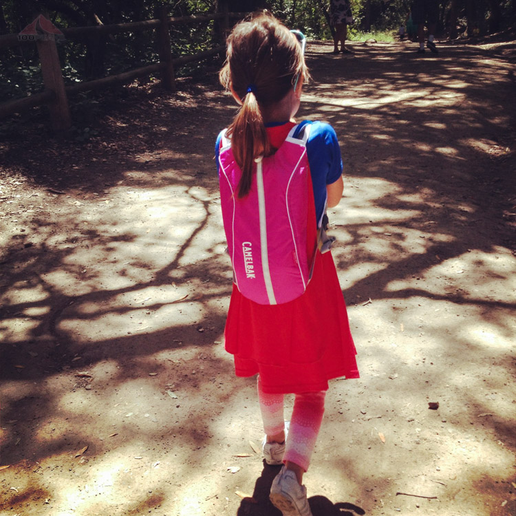 Supergirl with her backpack