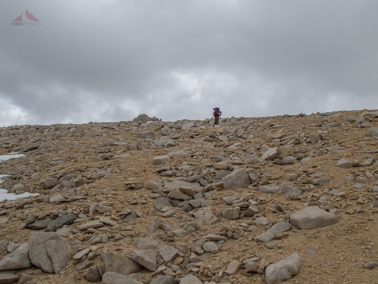 Scrambling up the scree slope, with Discovery Pinnacle peeking over the edge to the left