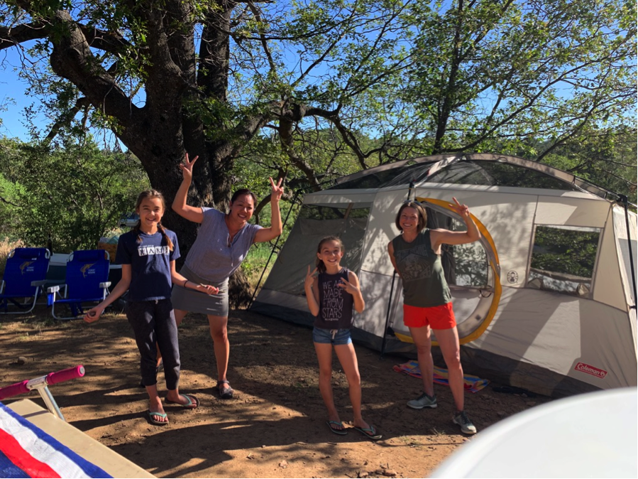 The tent is up! 'Go big or go home' is our motto. Our shelter is a luxurious 10-person tent, complete with a room divider, so that the girls can stay up all night while us moms can enjoy our beauty sleep.