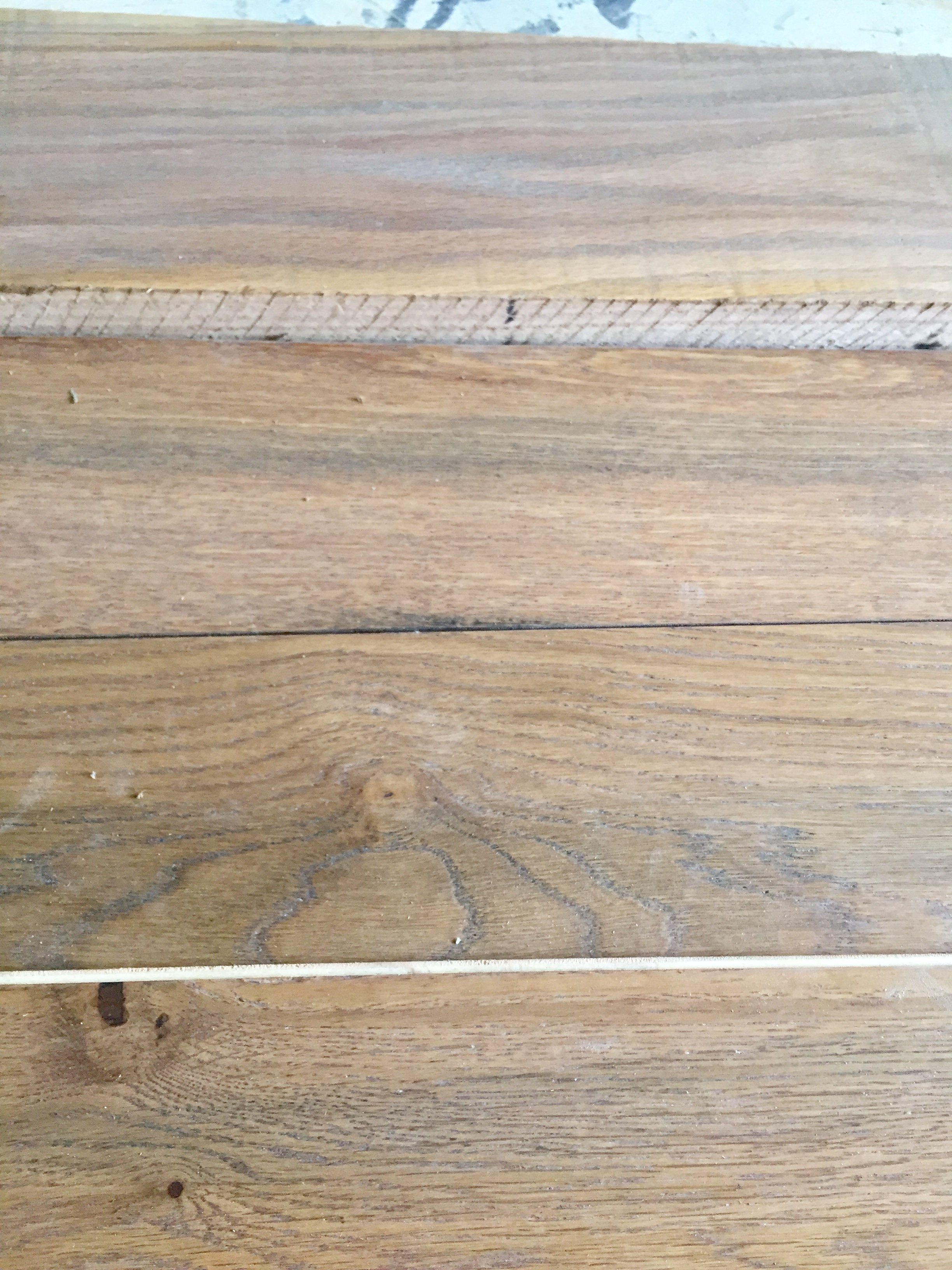 Heavy cerused oak planks for built-ins next to new engineered wood flooring