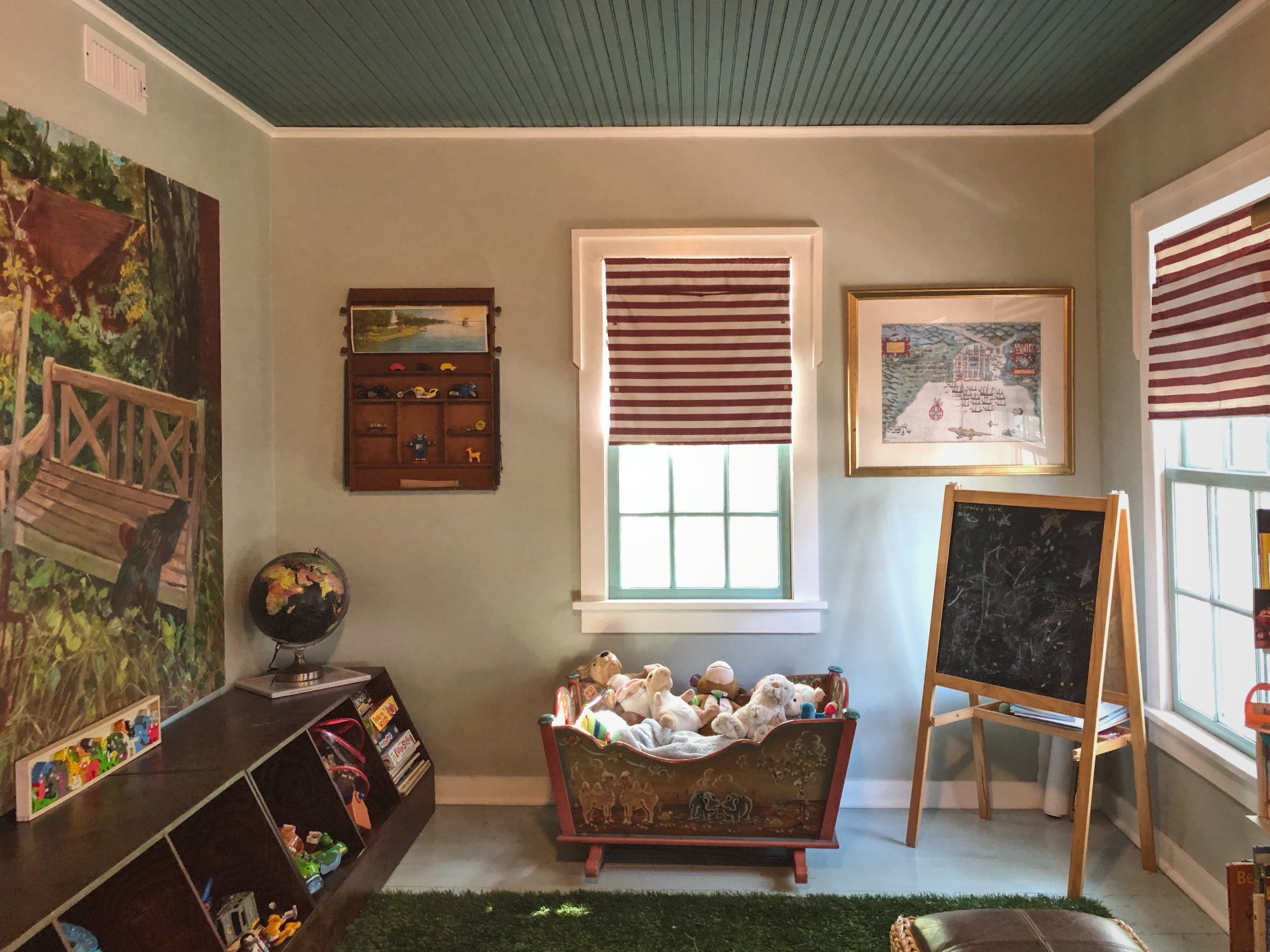 Garden painting with cubbies for storage underneath