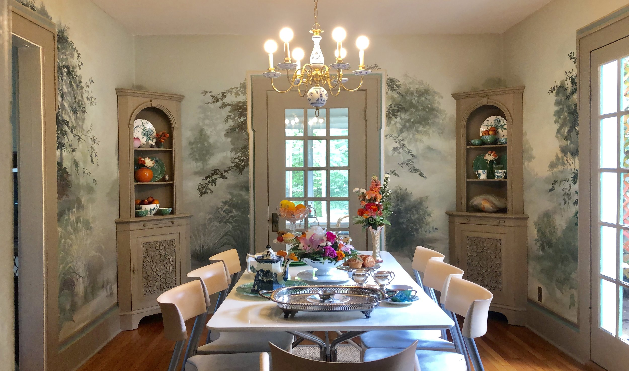 China Hutches filled with Jasper Conran Wedgewood china anchor this dining wall mural