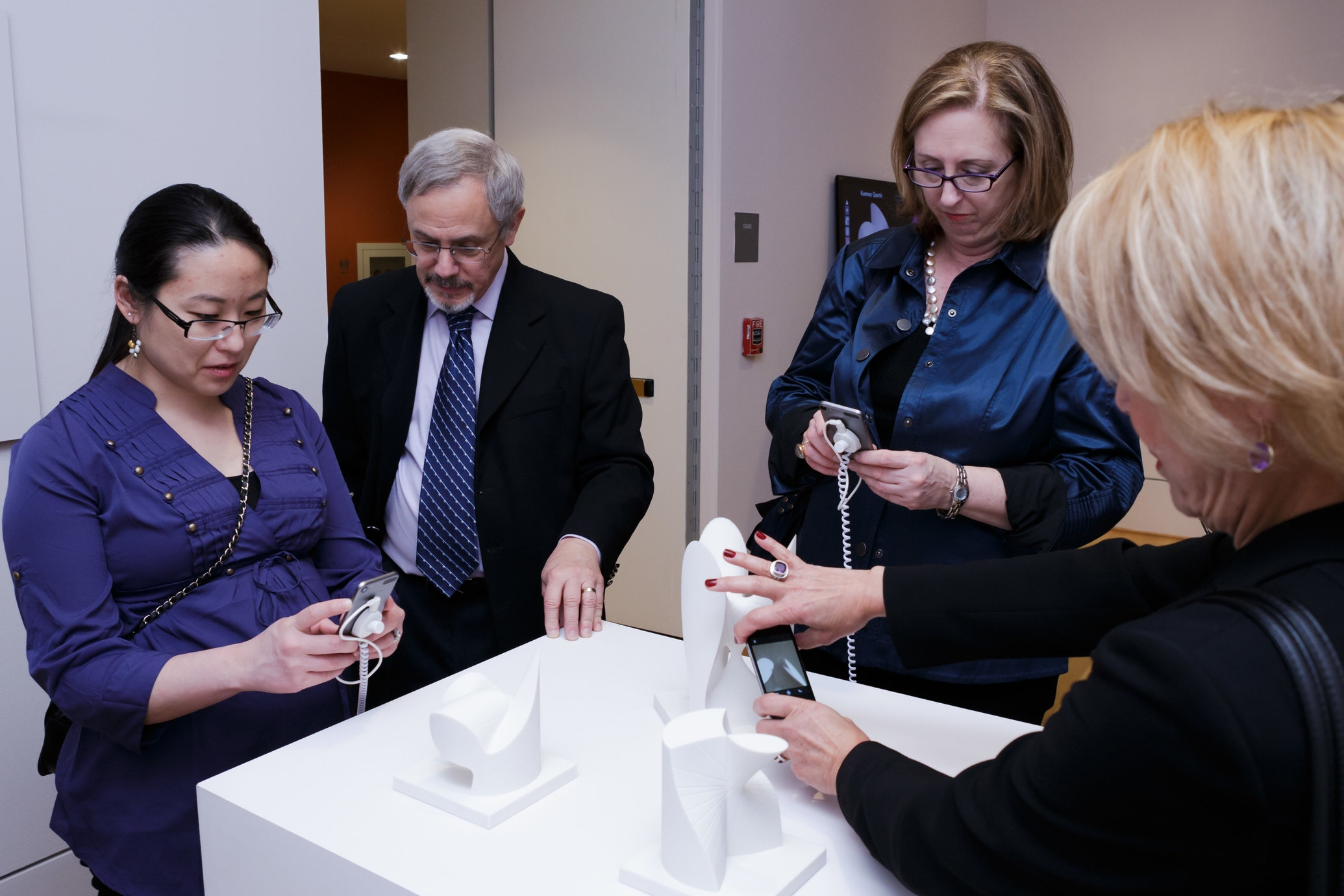Visitors capture Instagrams of mathematical models at the Phillips Collection, 2015.