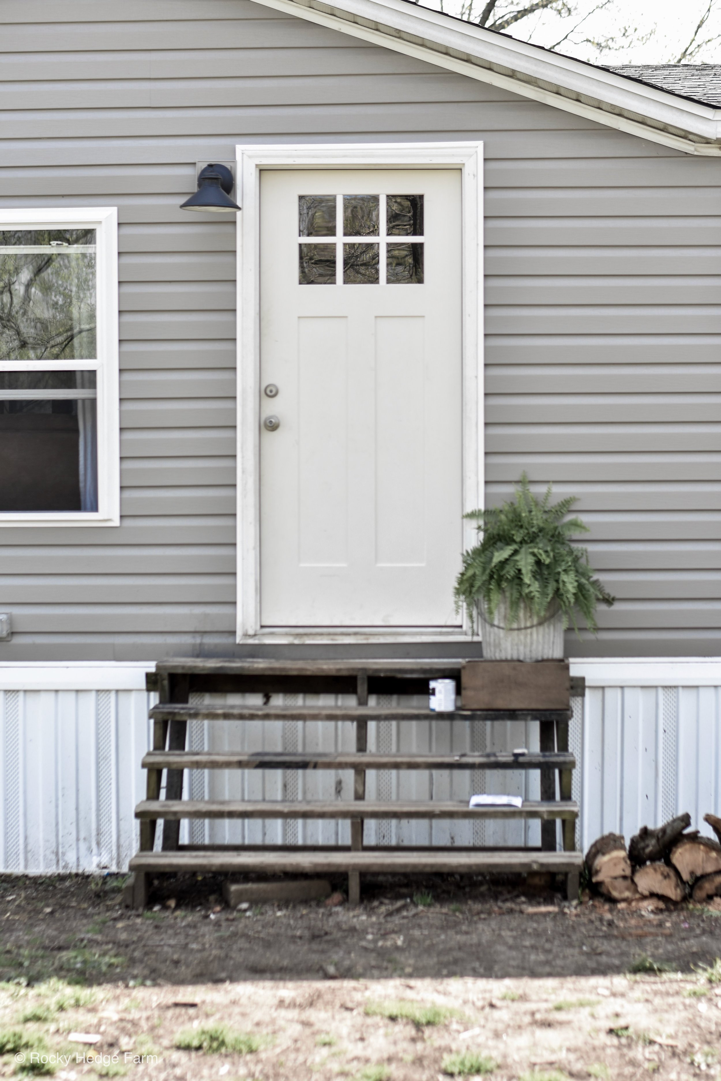 Double Wide Mobile Home Exterior Remodel - Gray Siding - White Door - White Trim | Rocky Hedge Farm