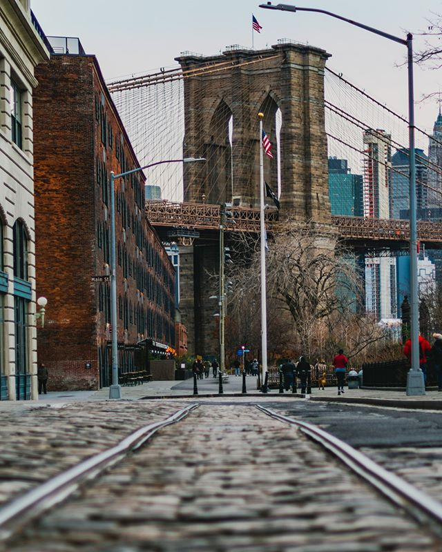 I was Down Under the Manhattan Bridge Overpass and snapped this awesome shot of the Brooklyn Bridge. Did you know why the neighborhood is called DUMBO? Let me know under the tracks.