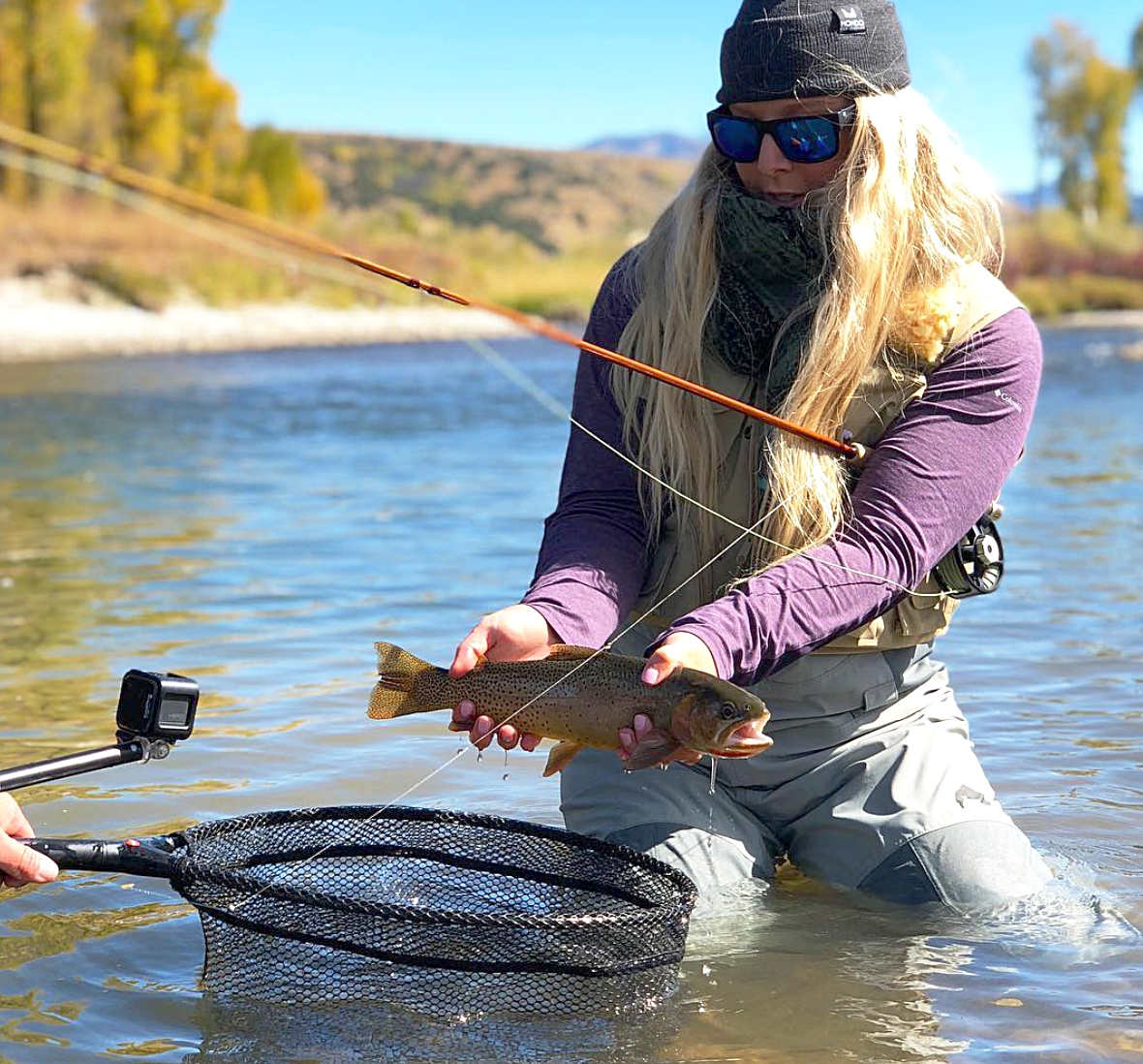 Haley Miller on the South Fork of the Snake River, Idaho with a beautiful cutthroat trout.