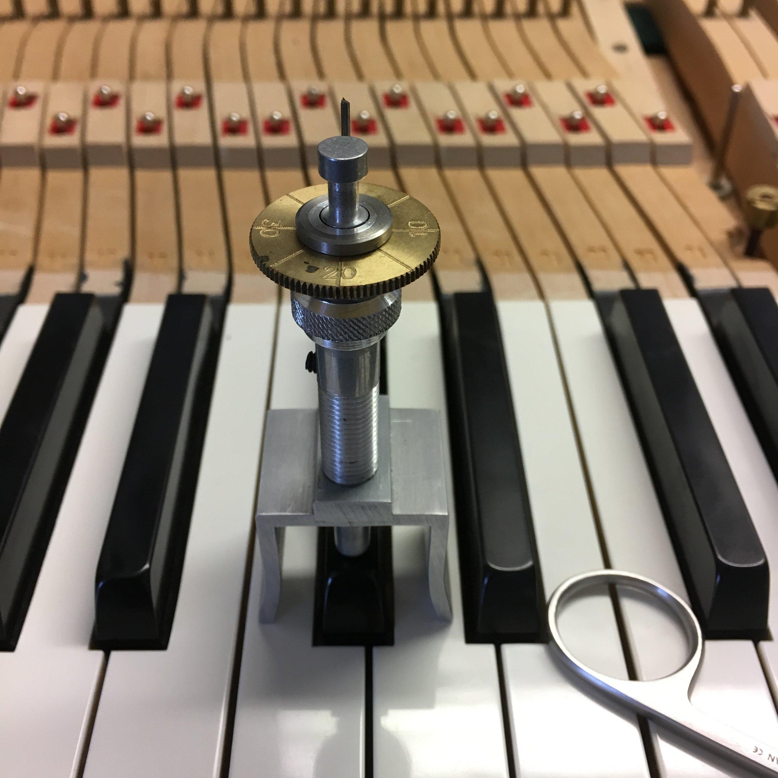 Leveling black piano keys.
