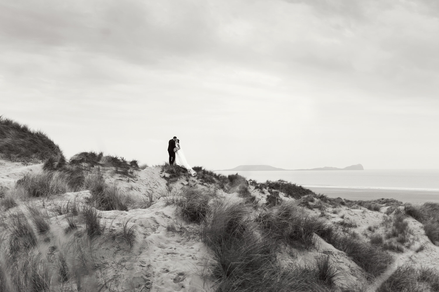 Wedding portraits at Llangennith beach, looking over towards Worm's head, Rhossili.