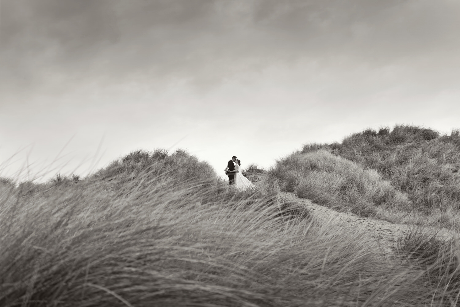 Cheeky little kiss in the sand dunes at Llangennith.