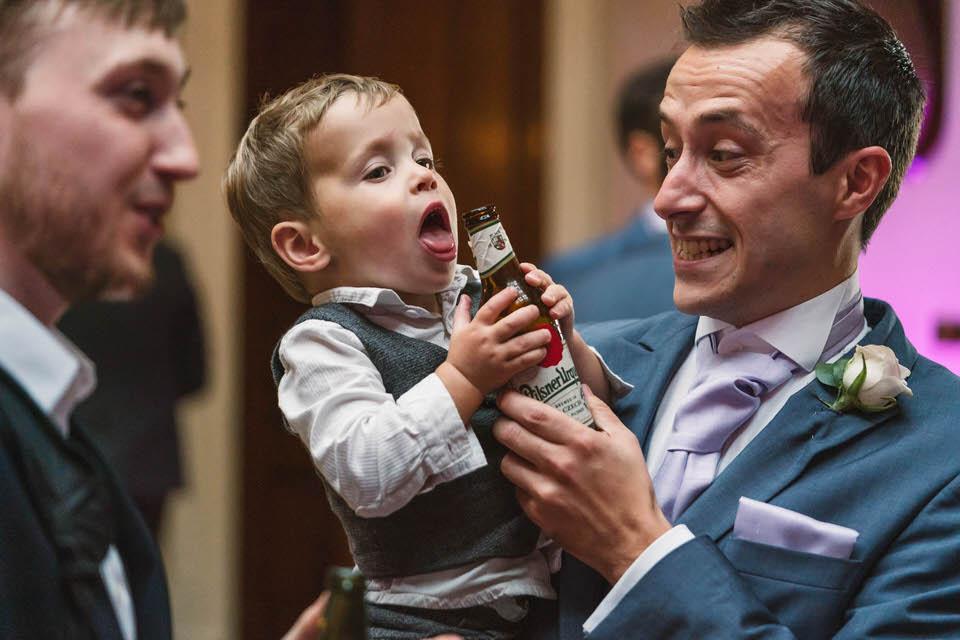 candid wedding moment child drinking beer in whitebourne hall, worcester
