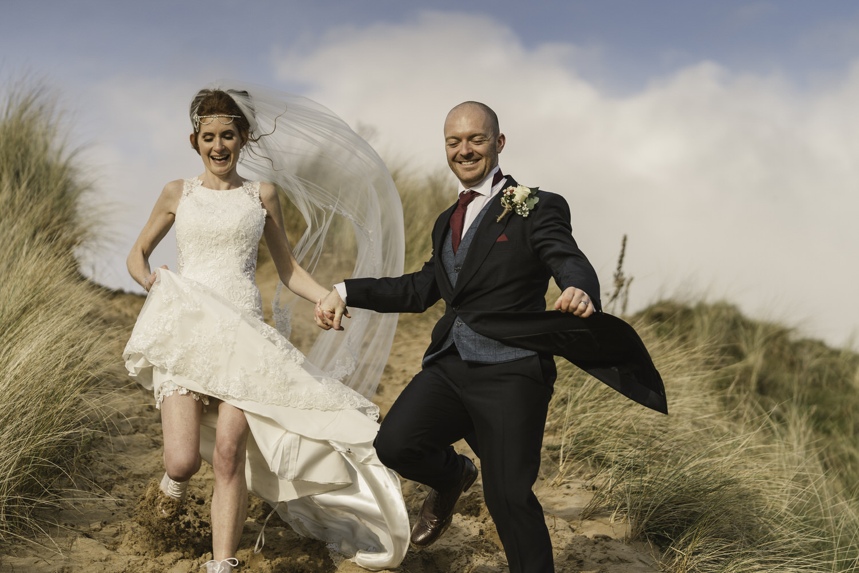 oxwich bay running wedding couple