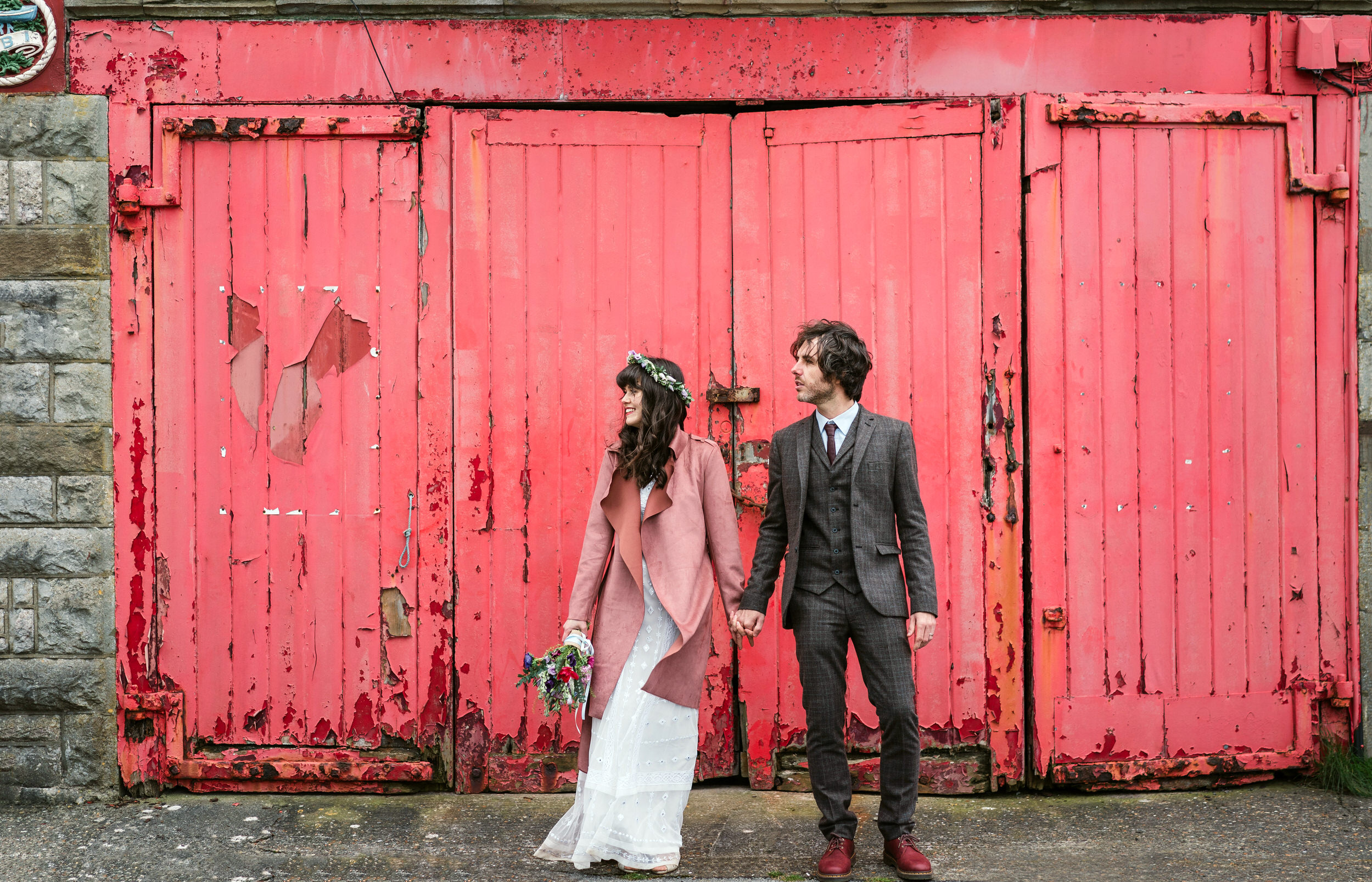 Swansea_wedding_photography_at_mumbles_pier_rustic_red_doors.jpg