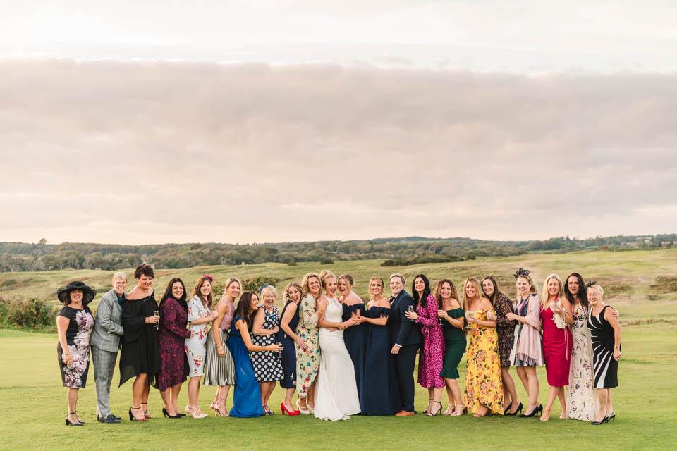 pennard castle wedding friends photo at sunset.jpg