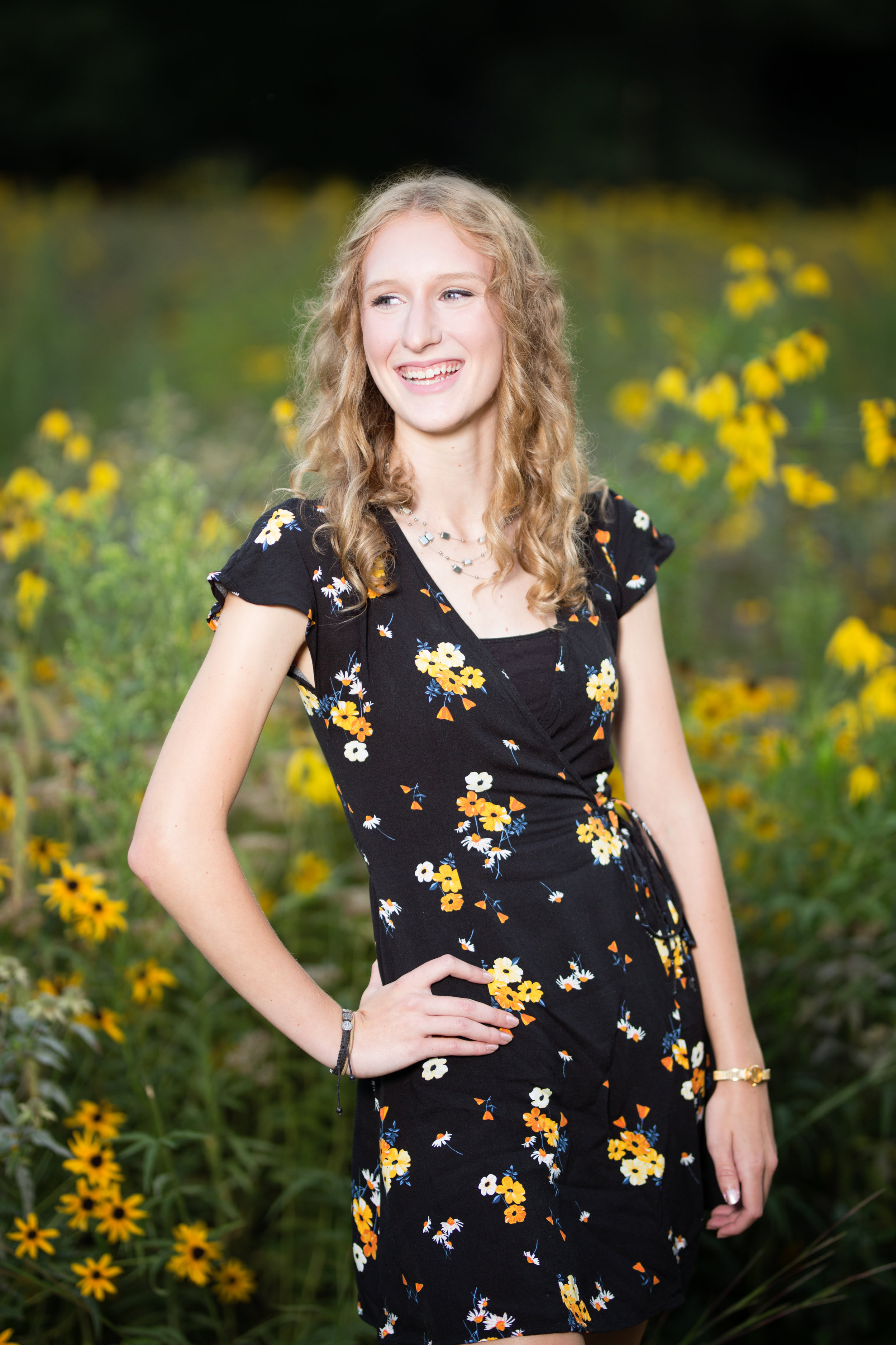 girl senior picture with yellow flowers