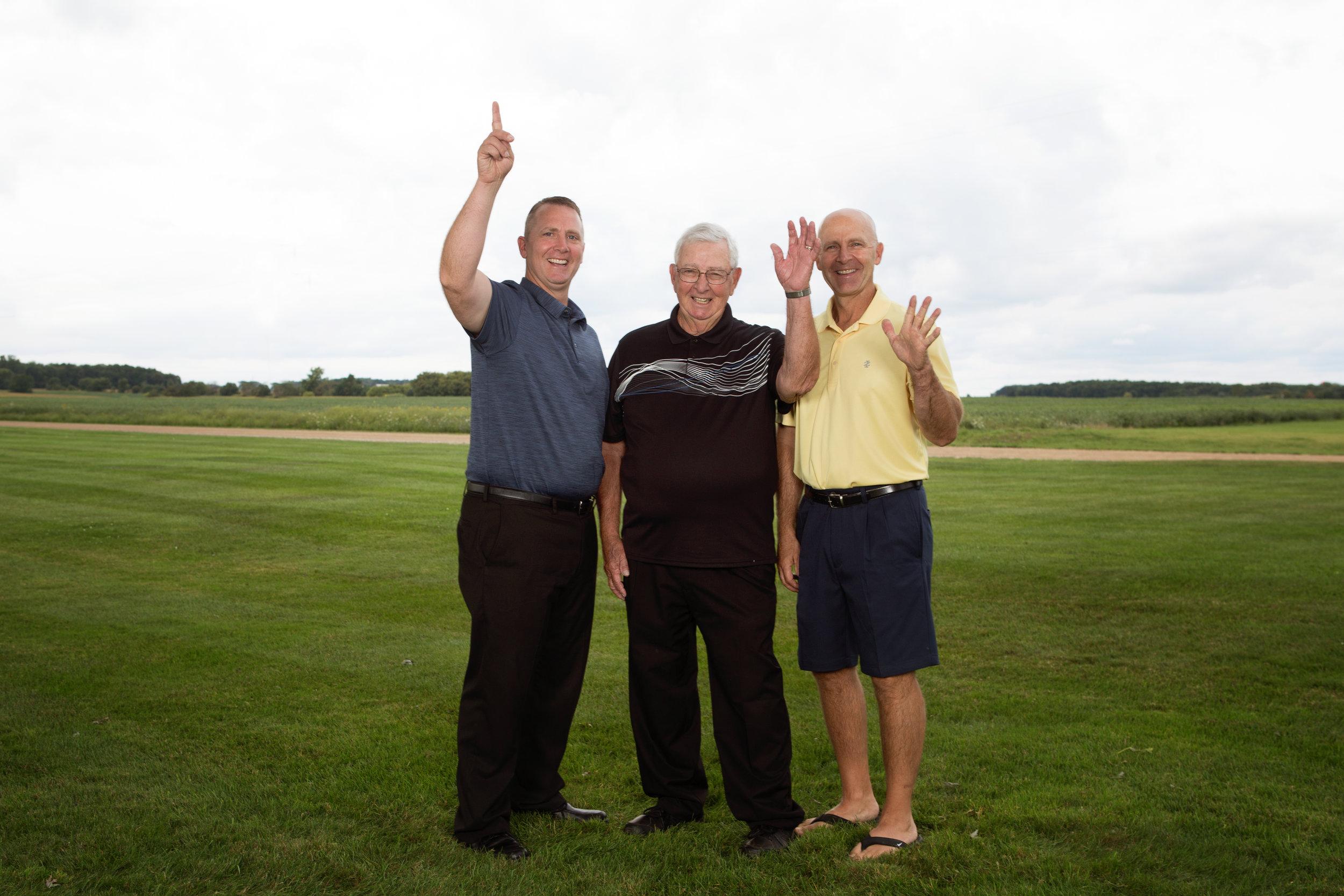 group of men waving