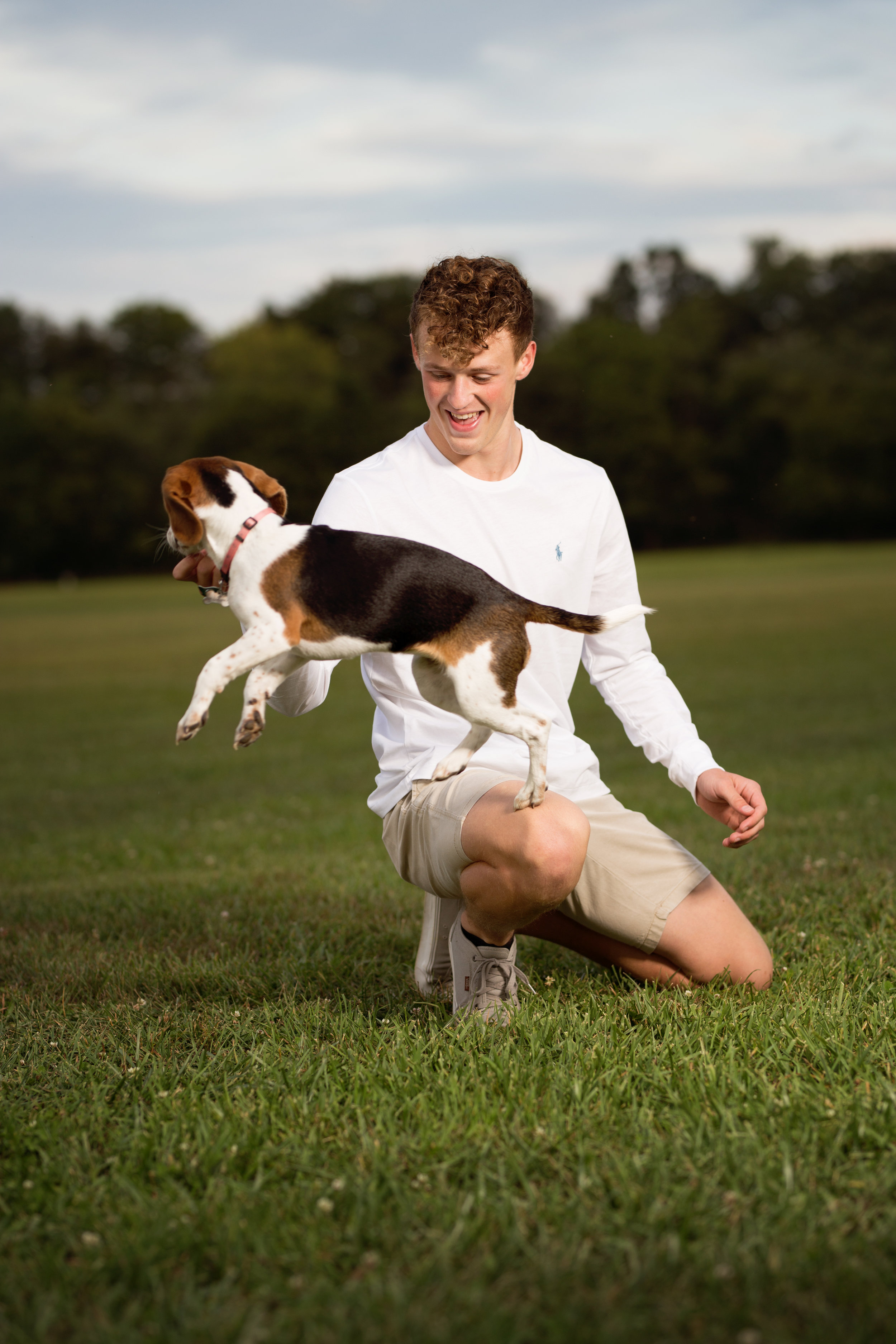 boy with jumping puppy