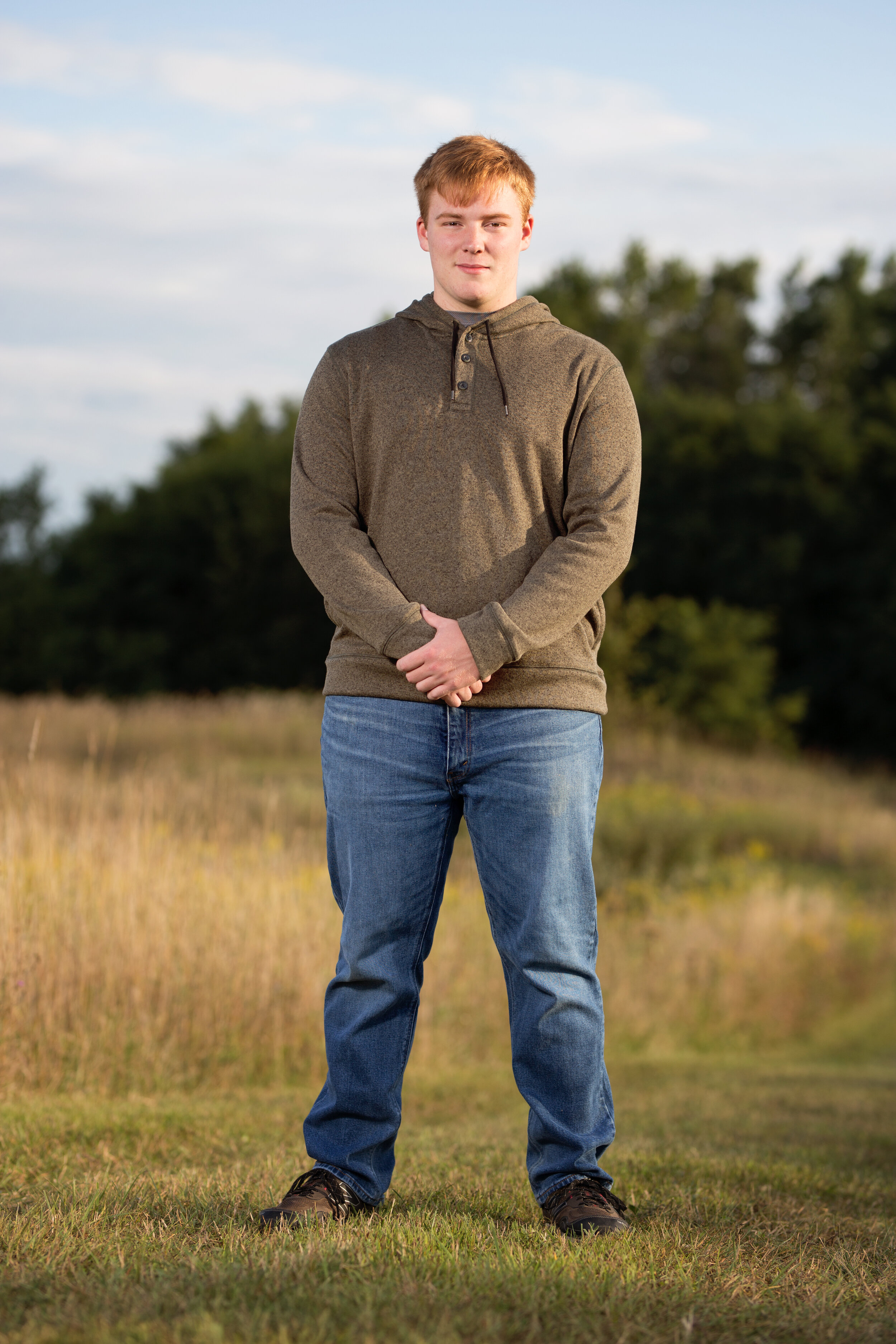 senior picture of boy standing