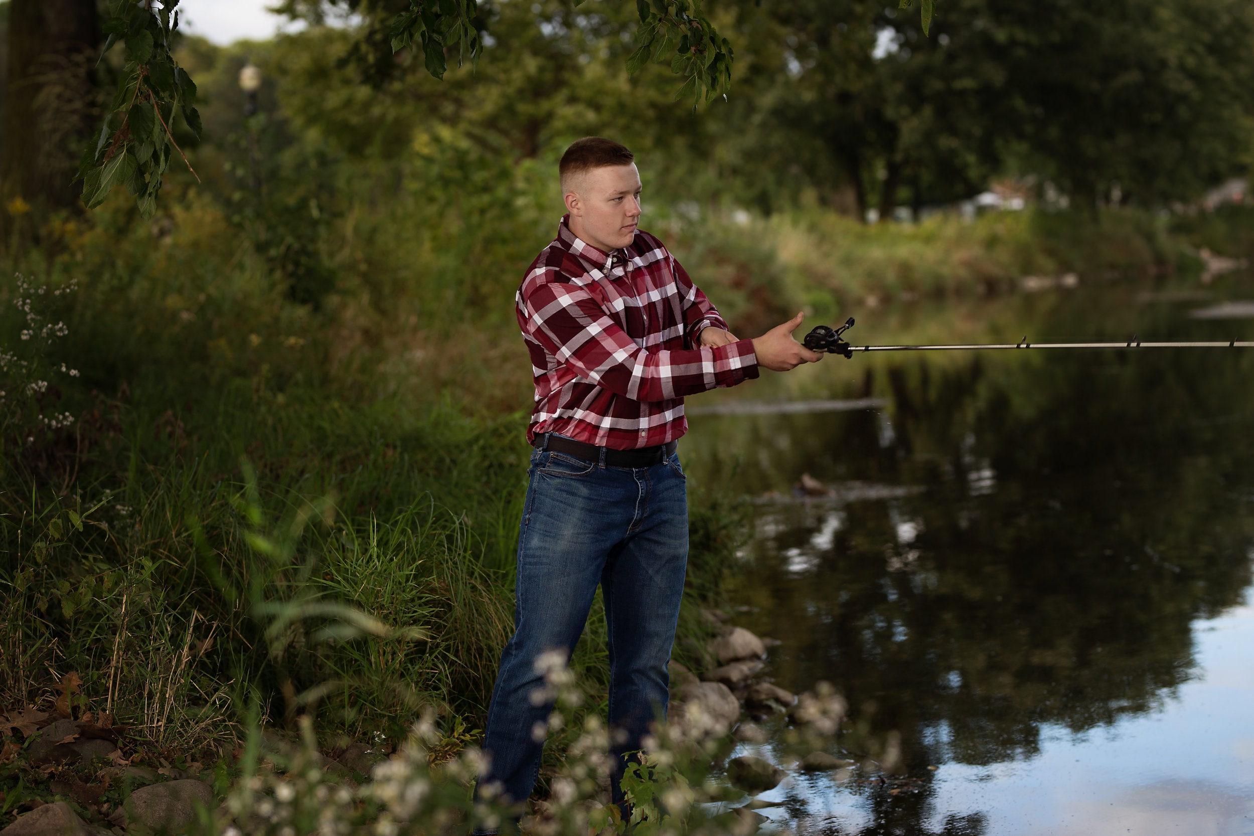 senior picture of boy fishing