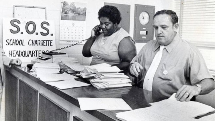 "Ann Atwater and C.P. Ellis at the ""Save Our Schools"" (S.O.S) charrette headquarters in 1971."