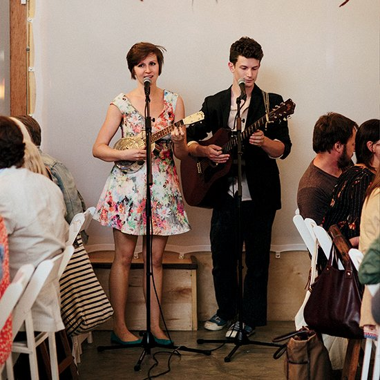 Amy and Eben Hoffer play music at the very first dining event for Spring Street Social Society