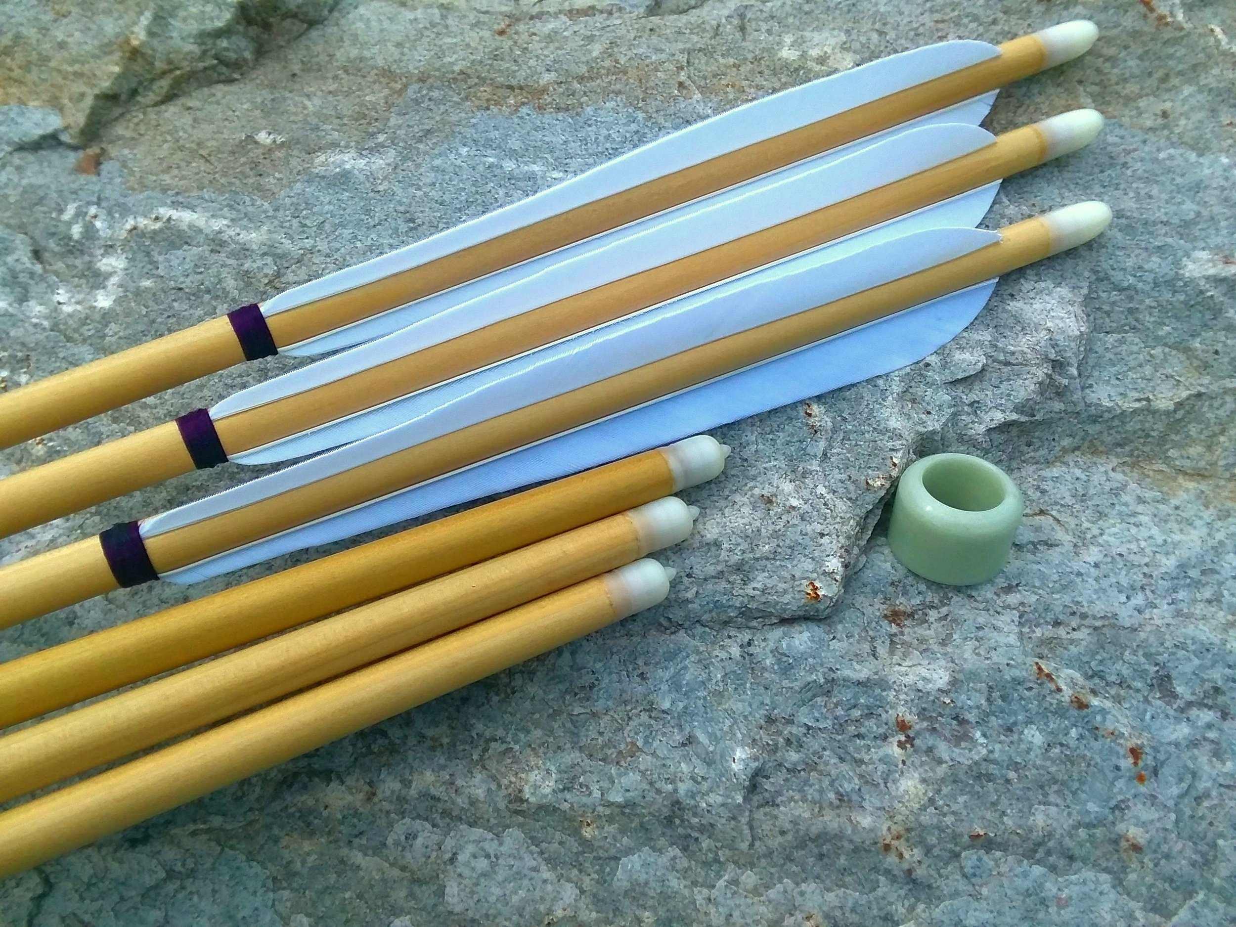 Our Manchu arrows seen here with our exotic Manchu ring, rather jade like in appearance.