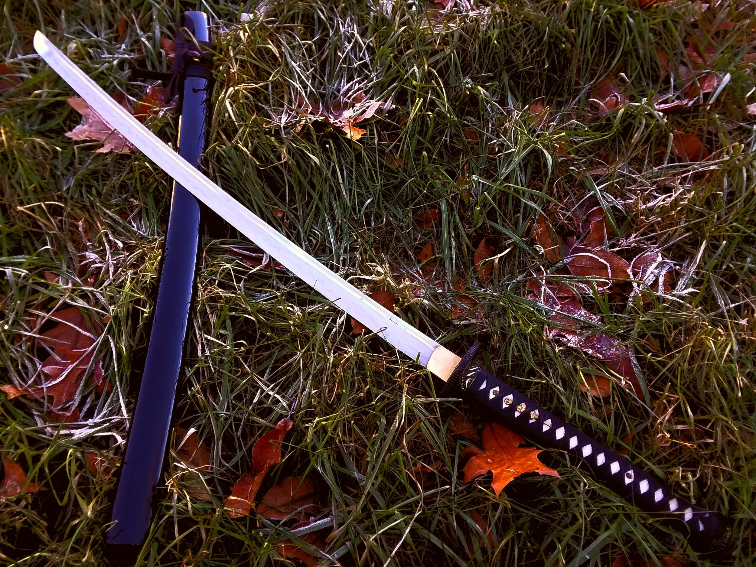 A beautiful and fully functional katana with differentially hardened blade, ray skin handles, tight wrapping, and lacquered saya.