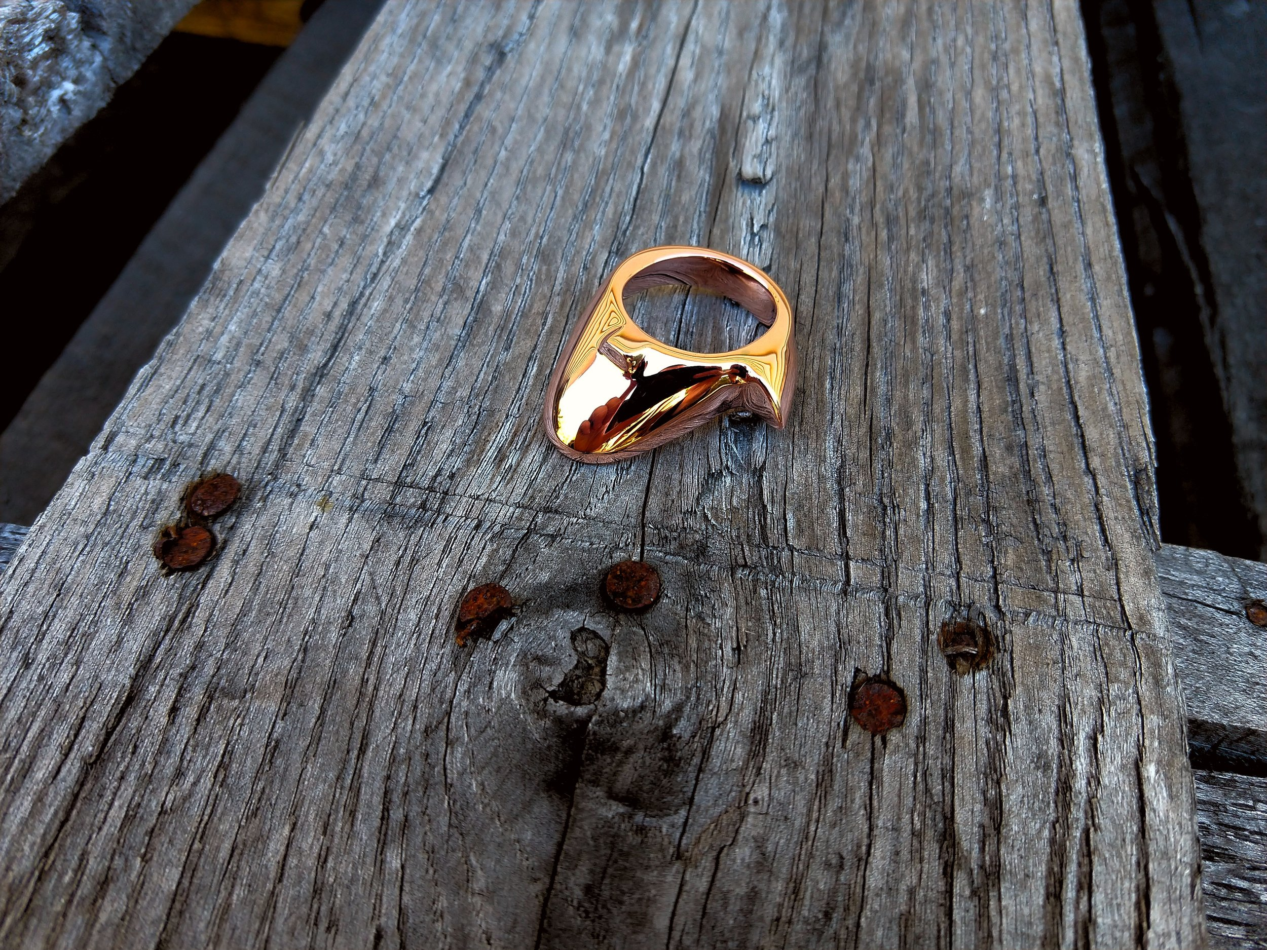A recombination of our tongue and chinese spur rings in solid copper.