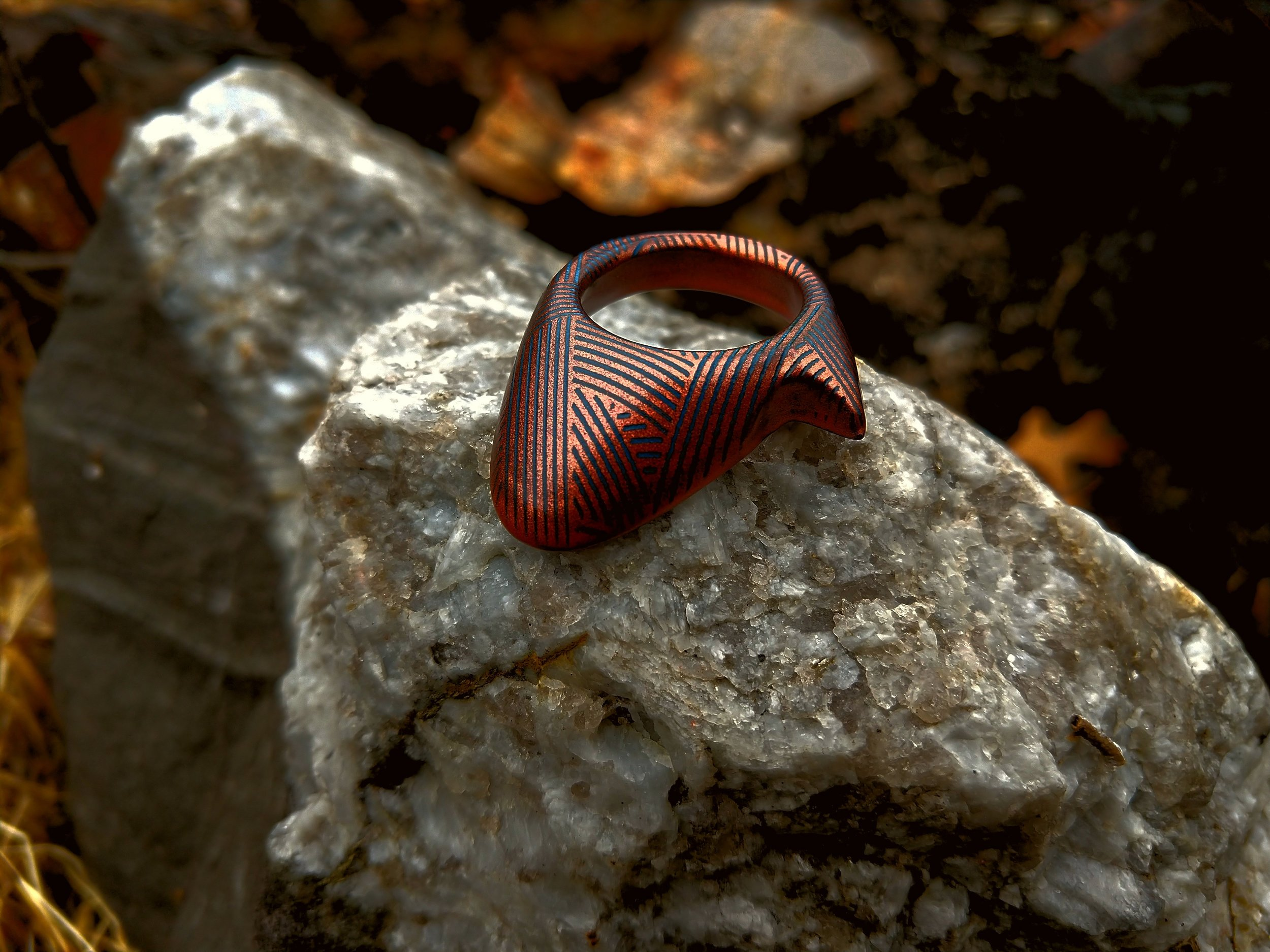 One of our Chinese Spur rings in Nocturnal Blue given a copper coating and weave pattern carving
