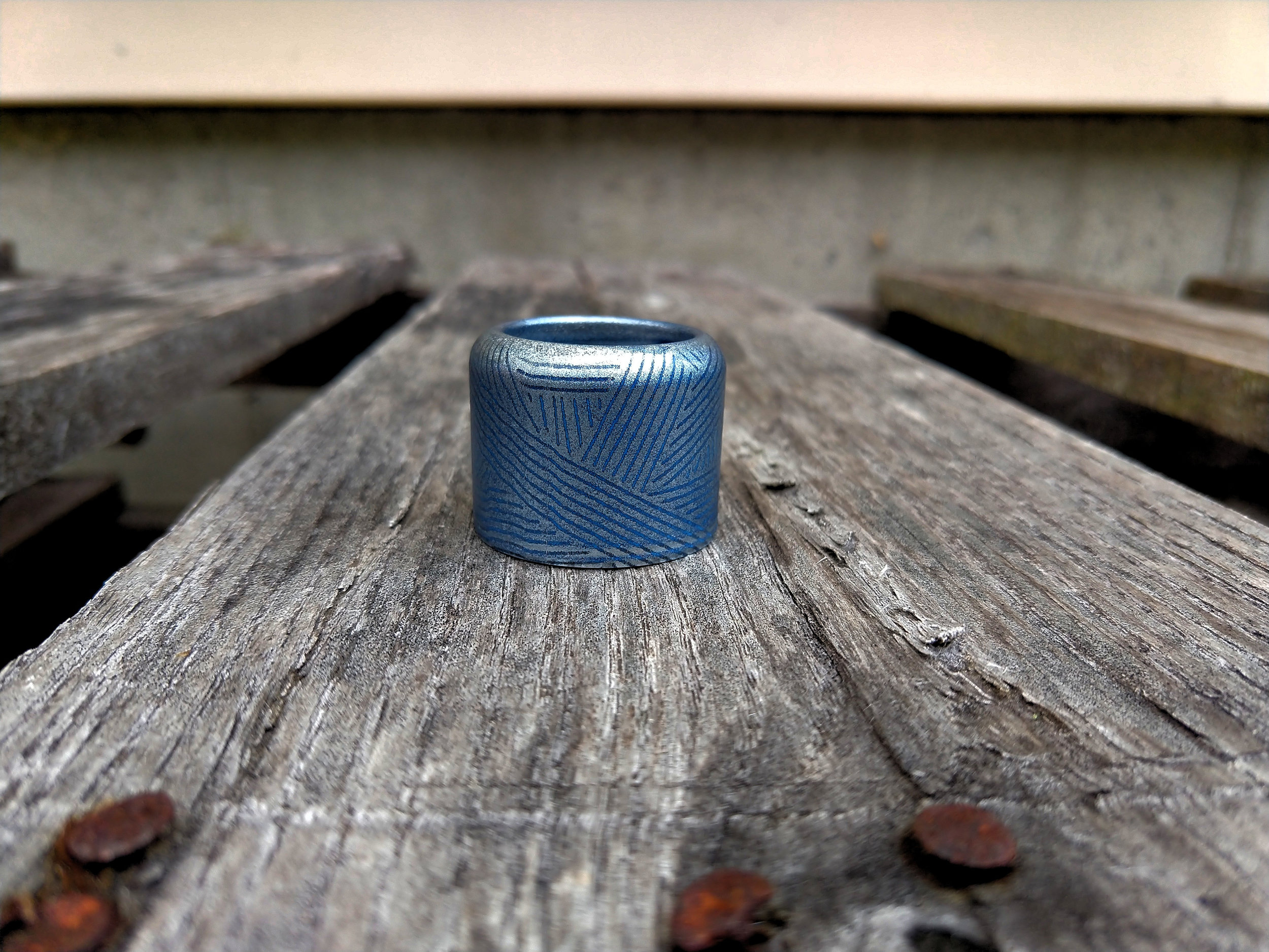 Manchu ring silver over noctural blue, weave pattern.