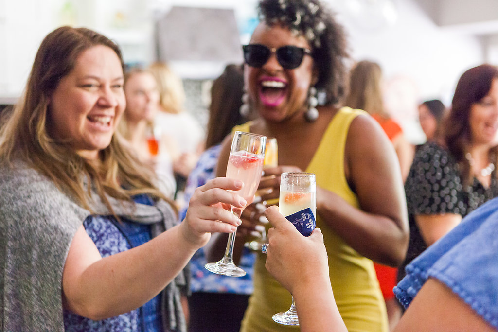 Small business owners celebrating with mimosas