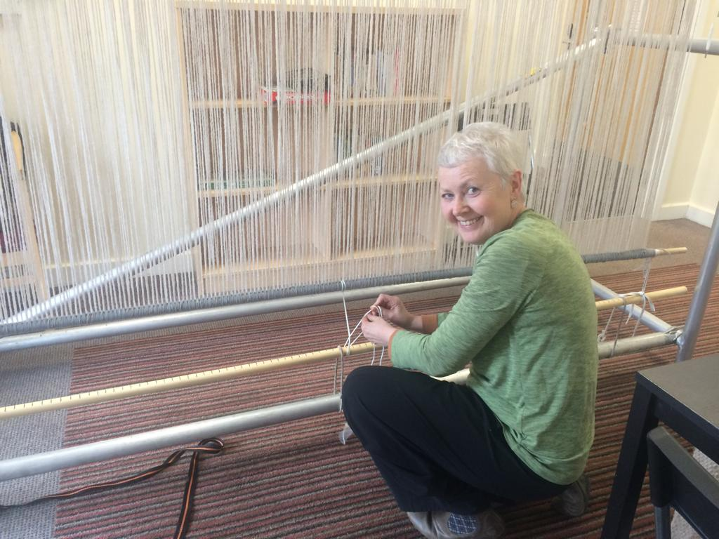 - Attaching the Navajo warp to the scaffolding frame