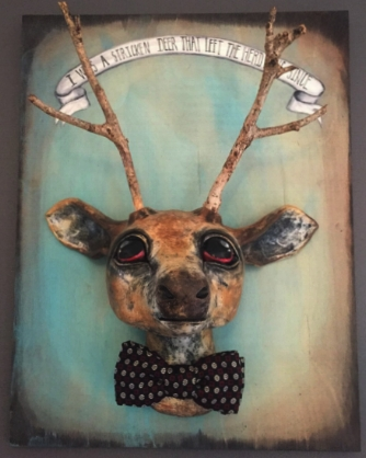 """DEER HEAD   Hand sculpted with paper clay. He was painted with acrylic paint and sealed with matte polyurethane. His antlers are real branches found on a walk in the woods. The bow tie is vintage. The wooden plaque measures 18"""" tall X 14"""" wide. The Deer Head protrudes from the plaque 8"""".The hand written banner was découpaged in place with this quote:""""I WAS a stricken deer that left the herd long since..."""" By William Cowper (1731–1800) [From Book III, The Garden]  I WAS a stricken deer that left the herd Long since; with many an arrow deep infixed My panting side was charged, when I withdrew To seek a tranquil death in distant shades. There was I found by One who had Himself 5 Been hurt by the archers. In His side He bore, And in His hands and feet, the cruel scars. With gentle force soliciting the darts, He drew them forth, and healed and bade me live. Since then, with few associates, in remote 10 And silent woods I wander, far from those My former partners of the peopled scene; With few associates, and not wishing more. Here much I ruminate, as much I may, With other views of men and manners now 15 Than once, and others of a life to come. I see that all are wanderers, gone astray Each in his own delusions; they are lost In chase of fancied happiness, still wooed And never won. Dream after dream ensues, 20 And still they dream that they shall still succeed, And still are disappointed. Rings the world With the vain stir. I sum up half mankind, And add two-thirds of the remaining half, And find the total of their hopes and fears 25 Dreams, empty dreams."""