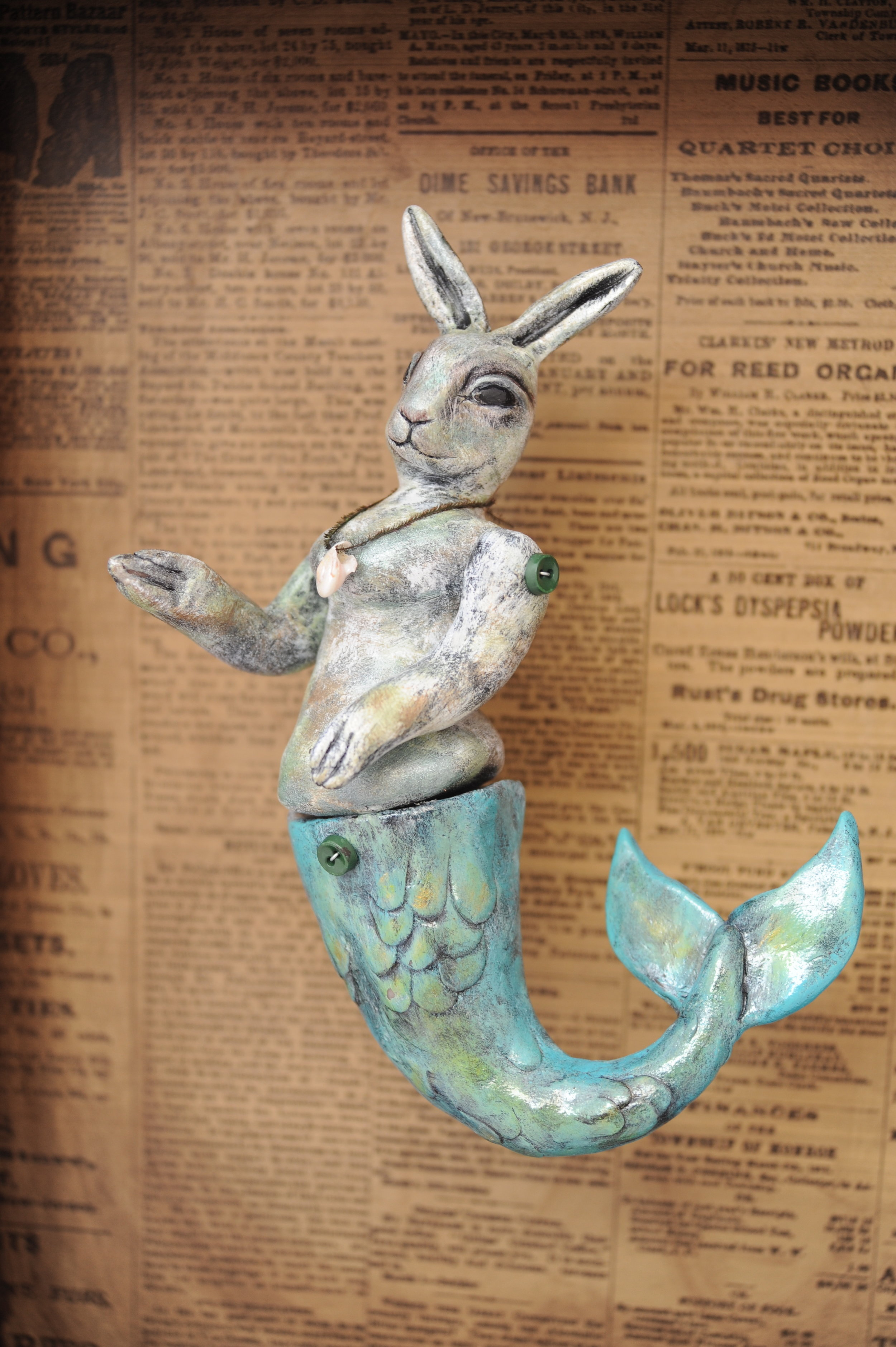 MERBUNNY   Created as part of my Circus Curiosities series. Her arms and tail move. Sculpted from clay and set in a salvaged drawer. Lit with an electric light.  Photo by  Rebecca Duerr